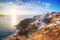 Oia town on Santorini island, Greece at sunset. Famous windmill Royalty Free Stock Photo