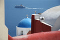 Oia village santorini a cruise ship in the waters of island greece Royalty Free Stock Image