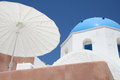 Oia village santorini a white sunroof umbrella in island greece Stock Photos
