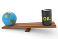 Oil barrel and earth globe on a scales. Stock Photo