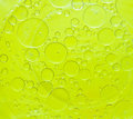 Oil bubbles abstract drops on a water surface background Royalty Free Stock Photos