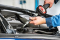 Oil change with an electronic dosage system Royalty Free Stock Photo