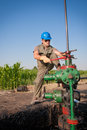 Oil company worker on the well Royalty Free Stock Image