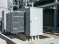 Oil cooled transformer for powering an industrial mining facility with containment in case of a leak Royalty Free Stock Image