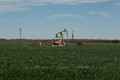 Oil donkey a photograph of working inland pump nodding in the fields of west texas usa taken on a typical sunny day Stock Images