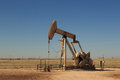 Oil donkey a photograph of working inland pump nodding in the fields of west texas usa taken on a typical sunny day Royalty Free Stock Image