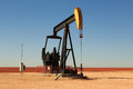 Oil donkey a photograph of working inland pump nodding in the fields of west texas usa taken on a typical sunny day Royalty Free Stock Photography