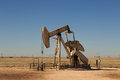 Oil donkey a photograph of working inland pump nodding in the fields of west texas usa taken on a typical sunny day Stock Image