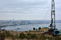 Oil drilling rig in baku capital of azerbaijan with view over the city and caspian sea for gas takes place within this is a socar Royalty Free Stock Images