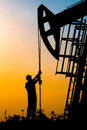 Oil field, the oil workers are working Royalty Free Stock Photo
