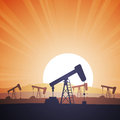 Oil field vector illustration of an with rigs on the evening Stock Image