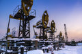 Oil Field. Winter industrial landscape with an oil pump Royalty Free Stock Photo