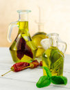 Oil flavored with herbs and spices bottles Stock Photos