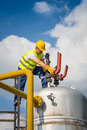 Oil and gas production operator with yelow helmet Stock Photo