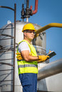 Oil and gas production operator with yelow helmet Stock Photography