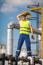 Oil and gas production operator with yelow helmet Royalty Free Stock Image