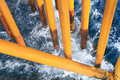 Oil and gas surface casing at offshore platform with ocean wave Royalty Free Stock Photo