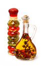 Oil with herbs spices and seasonings olive in small bottle isolated over white background Stock Images