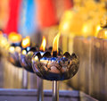 Oil lamp arranged in patterns at the temple Royalty Free Stock Images