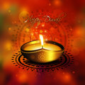 Oil lamp with diwali diya greetings over colorful background Royalty Free Stock Photo