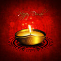 Oil lamp with diwali diya greetings over red background Royalty Free Stock Image