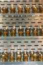Oil lamps many alight on metal frame Stock Photo