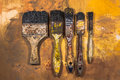 Oil paint brushes on wood painted background Royalty Free Stock Photo