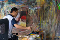 image photo : Oil Painter Working