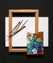 Oil painting set studio photography of paint utensils on black background Stock Image