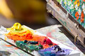 Oil paintings close up artist s pallete with and picture Royalty Free Stock Photos