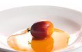 Oil palm fruit and cooking oil fresh on white plate Stock Images
