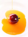 Oil palm fruit and cooking oil plam with drops of on white background Royalty Free Stock Image