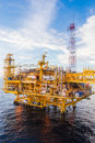 Oil platform in the sea yellow color Stock Photo