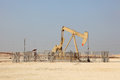 Oil pump jack in the desert Stock Image