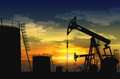 Oil pump jack and oil tank Royalty Free Stock Photo