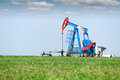 Oil pump jack on oilfield Royalty Free Stock Image