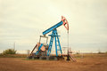 Oil pump oil industry equipment at sunny day Royalty Free Stock Photos