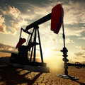 Oil pump on the sunset sky Royalty Free Stock Photos
