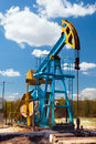 Oil pump under blue sky Stock Photos