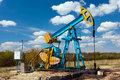 Oil pump under blue sky Royalty Free Stock Images