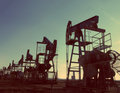 Oil pumps silhouette - vintage retro style Royalty Free Stock Photography