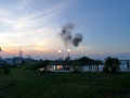 Oil refinery bursting flames at sunset close to camping site, Ve Royalty Free Stock Photo