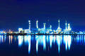 Oil refinery factory at twilight Royalty Free Stock Photos
