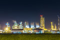 Oil refinery and petrochemical plant with cooling tower in twili Royalty Free Stock Photo