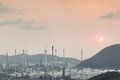 Oil refinery petrochemical plant in industial estate during sun landscape view of Stock Image