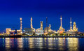 Oil refinery plant near river in early night light Royalty Free Stock Photography