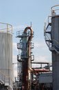 Oil refinery refractory tower for bitumen and tanks at Stock Image