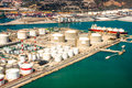 Oil refinery sea port aerial photo of area with petrol tanks and cargo with ship Stock Photos