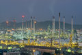 Oil refinery and storage tanks at twilight Royalty Free Stock Photo