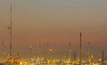 Oil refinery on Sunset background Royalty Free Stock Images